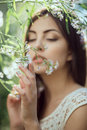 Wild flowers. Beautiful young woman portrait in flower field. Royalty Free Stock Photo