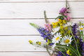 Wild flowers on old grunge wooden background chamomile lupine d Royalty Free Stock Photo