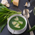 Wild garlic soup with parmesan a Stock Photos