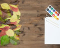 Wild grapes multicolored autumn leaves watercolor paints and bru Royalty Free Stock Photo