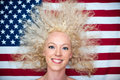 Wild hair woman on american flag pretty Royalty Free Stock Photos