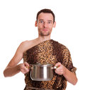 Wild man with cooked food in a stew pan funny animal fell holds isolated on white background Stock Photo