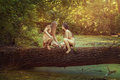 Wild men in the woods on a tree forest sitting and women and looking at each other Royalty Free Stock Images
