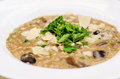 Wild mushrooms risotto and parmigiana detail Royalty Free Stock Photo
