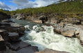 Wild river in the canyon in national park abisko sweden Stock Photos