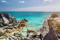 Wild rocky beach with clean water Royalty Free Stock Photo