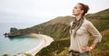Relaxed active woman hiker in front of ocean view landscape Royalty Free Stock Photo