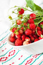Wild strawberries white bowl linen napkin Royalty Free Stock Images