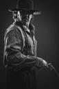 Wild west gunslinger frantic looking Stock Photo