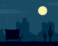 Wild west night background silhouette at with the moon mountains cacti and a coach Stock Photo