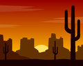 Wild west sunset background silhouette at with mountains and cactus Royalty Free Stock Image