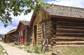Wild west town buildings authentic log homes and timber on an old fashioned street in america Stock Photos