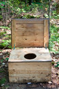 Wilderness toilet a rustic box with a hole cut in serves as a for camping Royalty Free Stock Photo