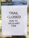 Wildfire trail closure sign trails closed notice in the rocky mountain national park due to the big meadows wild fire caused by a Stock Photo