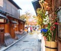 Wildflowers in a vase on the facade of a building, Kyoto, Japan. Close-up. Royalty Free Stock Photo