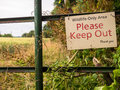 Wildlife area entrance sign on a farm gate gate at the to a saying only please keep out shropshire england Royalty Free Stock Images