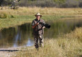 Wildlife photographer on location botswana a in the okavango delta in the camera is a dslr with a mm telephoto lens Stock Image