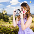 Wildlife photographer shooting insects and nature cute young female with old vintage film camera Stock Photography