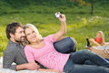 It will be the great shot loving young couple taking the photog photographs of themselves on summer picnic Stock Photo