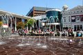 Williamson square liverpool the playhouse theatre in with fountains in the foreground and people enjoying the summer sunshine Royalty Free Stock Photos