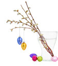 Willow twigs and hanging easter eggs multicolored on white bacjground Stock Image