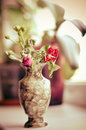 Wilted rose in a vase Royalty Free Stock Photography