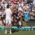 Novac Djokovic, Serbian player, wins Wimbledon. In the photo he holds the trophy on centre court in front of press photographers. Royalty Free Stock Photo
