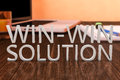Win win solution letters on wooden desk with laptop computer and a notebook d render illustration Stock Photos