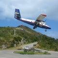 Winair plane landing at St Barts airport. Royalty Free Stock Photo