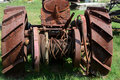 Winch antique on the rear of a tractor used in the oil drilling business Royalty Free Stock Photo