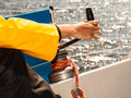 Winch capstan with rope on sailing boat male hand yachting yacht in blue baltic sea sunny day summer vacation tourism luxury Stock Photos