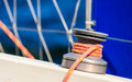 Winch capstan with rope on sailing boat. Royalty Free Stock Photo