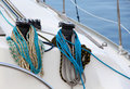 The winches and ropes of a sailboat detail detailed view deck with two very neat at marina landscape cut Royalty Free Stock Images