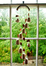 Wind chime of ceramic bells hanging in a window Stock Images