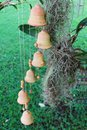 Wind chimes outside a cottage near an orchid Royalty Free Stock Photo