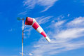 Wind direction indicator the control of a windsock inflated by the on the cloudy sky Royalty Free Stock Photo