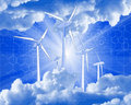 Wind-driven generators, rays of light & blue sky Royalty Free Stock Photo