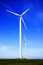 Wind energy aeolian turbines on a field Royalty Free Stock Photos