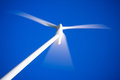Wind energy turbine close up photo with blue sky Stock Photography