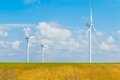 Wind energy turbines are one of the cleanest, renewable electric energy source, under blue sky with white clouds