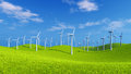 Wind farm on green hills at sunny day Royalty Free Stock Photo