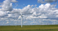 Wind farm on the prairie under white cloud Stock Photos