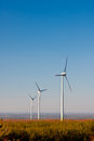 Wind farm turbines ecology three on a during sunny day Royalty Free Stock Photography