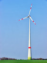 Wind generator modern in front of blue sky Stock Images