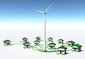 Wind generator supplys the houses a is supplying small homes by connecting them with green cables on a white ground and a blue sky Royalty Free Stock Image