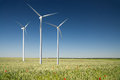 Wind generator turbine on spring landscape Royalty Free Stock Photo