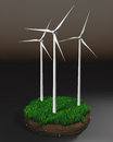 Wind generators on clod of earth three a grassy round a dark background Royalty Free Stock Photos