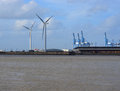 Wind generators and cranes Royalty Free Stock Photos