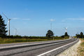 Wind generators near road Stock Photo