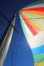 The wind has filled colorful spinnaker sail Royalty Free Stock Image
